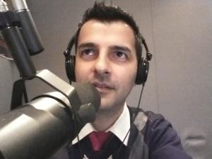 Sean Kheraj behind the mic